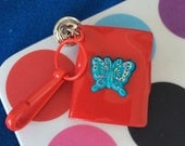 Vintage 80's Plastic Bell Clip Butterfly Notebook with Rainbow Paper Charm Toy Necklace Jewelry Pendant