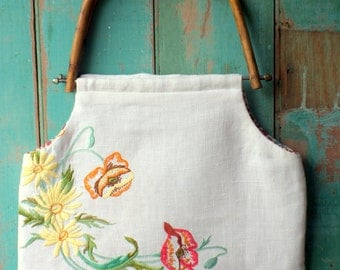Linen handbag made from a repurposed vintage embroidery with cane handles