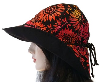 Reversible Wide Brim Sun Hat in black and electric tropical print with adjust fit plus chinstrap for boating/convertibles/windy days