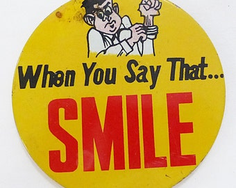 """Vintage tin button pin humor """"When you say that...SMILE"""" made in Japan"""