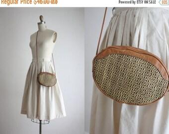 VACATION SALE. woven shoulder bag