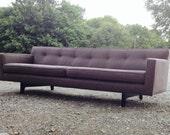Stunning Edward Wormley floating bracket sofa for Dunbar