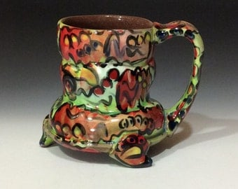 graffiti bulgy footed mug with red and lime green