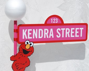 Sesame Street Sign with Lamppost and Elmo character in Pink and Red for Girl