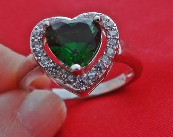Vintage silver tone size 8.25 ring with sparkly emerald rhinestone in great condition, appears unworn--signed 925 so assume this is sterling