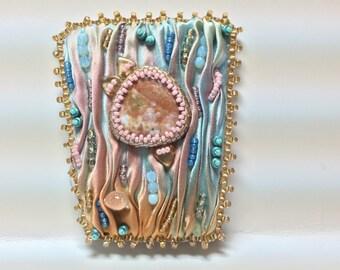Ocean jasper and shibori silk bead embroidered brooch