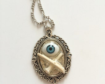 Antique Doll Eye with Real Rodent Bones - Necklace