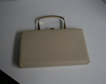 1960's tan clutch handbag with pockets and fold in handle