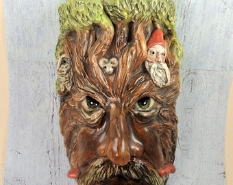 Hand sculpted ceramic Tree spirit or wood spirit wall pocket vase by Anita Reay AnitaReayArt Green Man