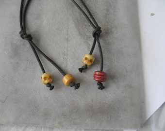 2 Carved  Skull Bone and Wood  Bead Necklaces