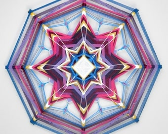 Taking Flight, a 24 inch, Ojo de Dios, by Inga Savage
