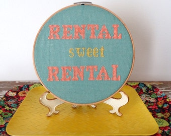 Cross stitch embroidered wall art.  Embroidery hoop art.  Rental, Home sweet home.  Hand stitched Art.   Coral, yellow Cross Stitch Picture