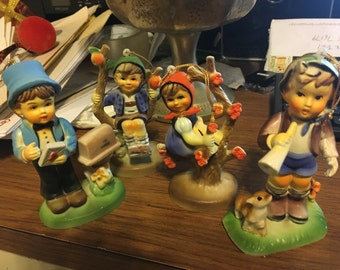 Hummel type hard resin figurines circa 1970's. Marked made in Hong Kong.