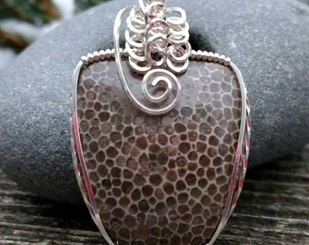 Charlevoix stone wrapped in argentium silver