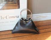 ON HOLD 60s Jackie O Black Leather Purse with Circular Metal Handles Wilson's Leather