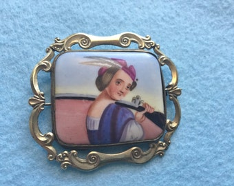 Victorian Brooch Painted Porcelain Girl with Shotgun