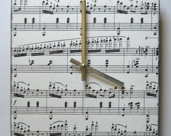 Wall clock. Music clock. Sheet music clock for a music lover.  Classical sheet music for piano.