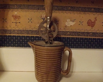 A & J Egg Beater And Pottery Measuring Cup 1923