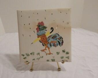 Rooster with umbrella vintage signed Wheeling tile