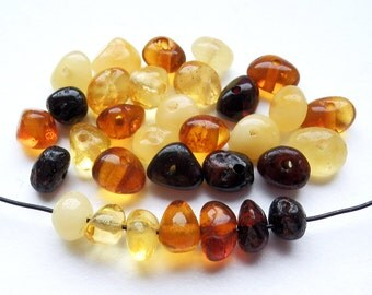 30pcs - Natural Baltic amber beads, polished rounded beads, cherry amber, cognac amber, yellow amber, 5-6 mm at widest part (#32)