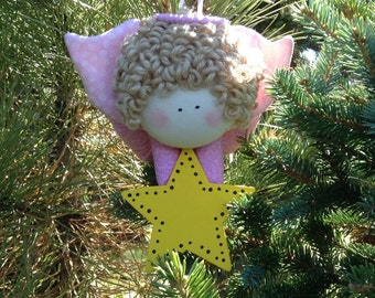Primitive Blonde Angel with a Pink Body and Pink Wings holding a Star Ornament