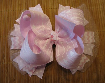 2909  light pink with white arrows grosgrain ribbon boutique bow with tulle and spikes