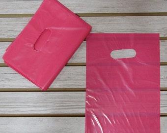 100 Pink Plastic Merchandise Bags (9 x 12 in.)