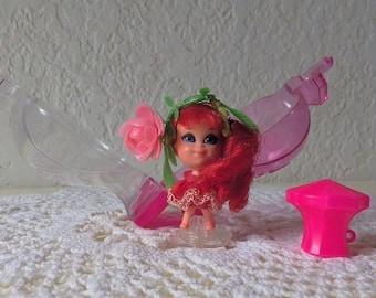 Liddle Kiddle Kologne Rose Bud doll, stand and bottle marked Mattel 1967