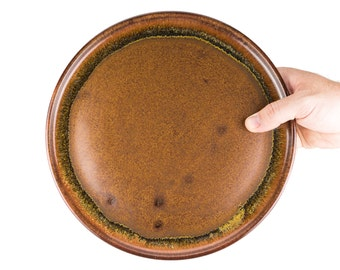 Wheel thrown stoneware pottery dinner plate in Toffee Glaze, and smooth style. Simple design, standard size. Sold individually
