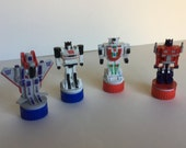 4 pc lot-vintage transformer style plastic self ink rubber stamps-used