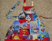 Femme Power Featuring Wonder Woman, Bat Girl, and Supergirl Girls Apron
