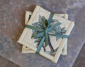 TAPESTRY PALM TREE and Leopard Print Coasters with faux Dupioni Silk bindings. Approx 4 1/2 inches square in tan green brown. Set of four