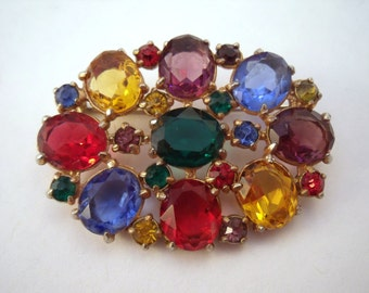 Vintage rainbow colour brooch with open back stones