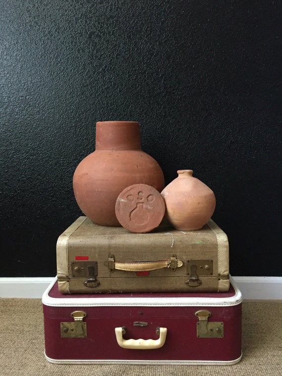 large terra cotta jug with lid