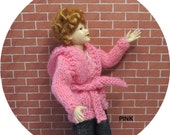 Dollhouse miniature pink hooded jacket for a 1/12th scale lady doll. Handknitted.