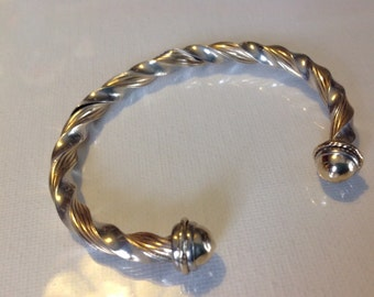 14K gold twisted ribbed design bangle with 925 sterling silver accents     VJSE