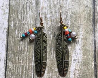 Beaded feather dangle earrings