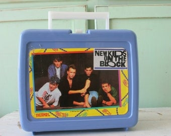 1990s NEW KIDS on the BLOCK Lunch Box....retro. jordan and jonathan knight. joey. donnie. danny. teens. pop music. band. 90s music. collect
