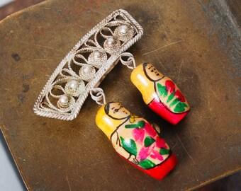 Vintage brooch embellished with Russian wood matryoshka doll, babushka doll, Russian nesting doll. toy