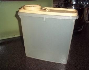 """One Vintage Tupperware Sheer Cereal Keeper 8"""" tall - beige lid!"""