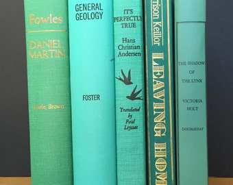 Five vintage decorative books in bright greens and blues