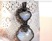 ON SALE Rainbow moonstone and sterling silver wire wrapped pendant