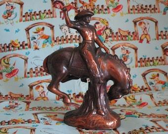 Cast Metal Bronzed Rodeo Rider Figurine   Bronco Riding
