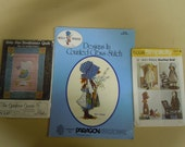 Vintage Holly Hobbie and Sunbonnet patterns:   Cross stitch designs 1972,  Simplicity rag doll & wardrobe 1973 and Sunbonnet quilt  1979