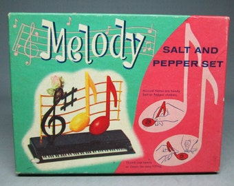 MELODY salt and pepper in the original box , plastic shakers , music note