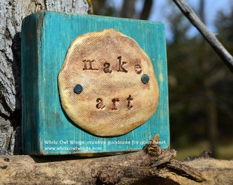 Make Art. clay impression mounted on turquoise painted wood block