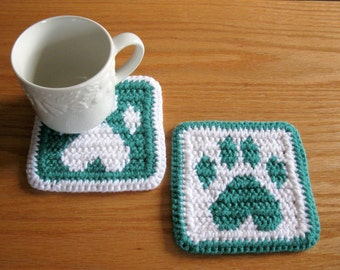 Crochet Coasters. Jade and white coaster set with dog paw prints. Pet lover gift