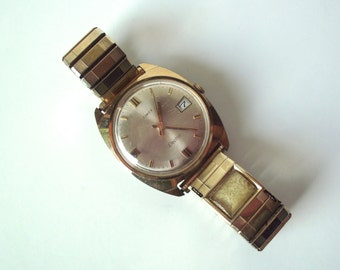 """Vintage 1970's Timex """"Electric"""" Watch with Date, Also Compartment in Band for a Scroll Calendar"""