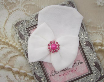 Newborn Hospital Hat, white with a hot pink rhinestone button, baby hat, from Lil Miss Sweet Pea Boutique
