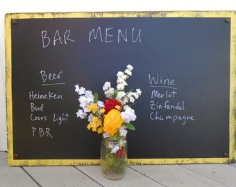 large chalkboard, different colors, bar menu, food menu, notes, memos, hours business